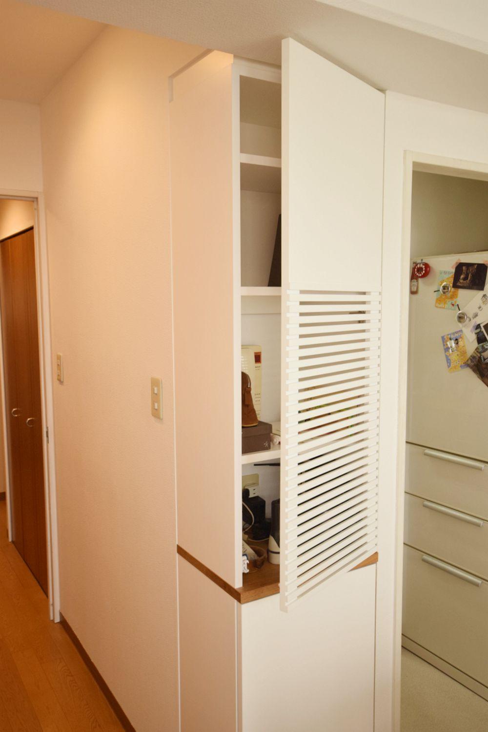 築30年以上の集合住宅のリビングをクルミの木と白い塗装でリフォーム