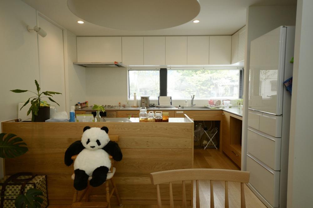 ナラとステンレスのL型キッチンと作業台